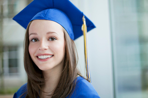 portrait of pretty graduate in cap and gownの写真素材 [FYI02289866]