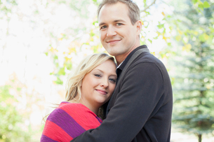 Portrait of attractive husband and wife hugging each other.の写真素材 [FYI02291200]