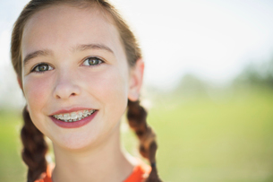 Portrait of female soccer player with pigtails and braces.の写真素材 [FYI02291505]