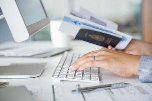 Verifying passport informationの写真素材 [FYI02291595]