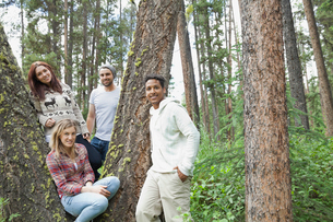 Portrait of friends standing in the forestの写真素材 [FYI02292638]