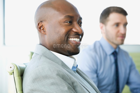 Side view of smiling businessman in meetingの写真素材 [FYI02292749]