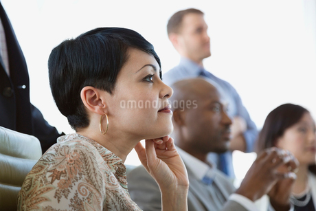 Side view of businesswoman watching presentationの写真素材 [FYI02294171]