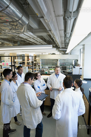 Scientists with digital tablet meeting in laboratoryの写真素材 [FYI02294766]