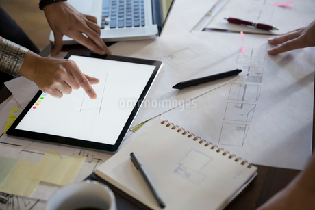 Designers with digital tablet and plansの写真素材 [FYI02294826]