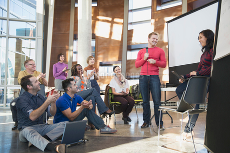 Group applauding coworkers presentation.の写真素材 [FYI02294907]