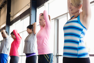 Group of people stretching in fitness classの写真素材 [FYI02299754]