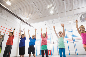 Children warming up in Crossfit classの写真素材 [FYI02300811]