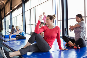 Group of people stretching on mat in fitness centerの写真素材 [FYI02300899]