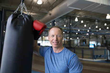 Portrait of smiling man boxing at gymの写真素材 [FYI02305595]