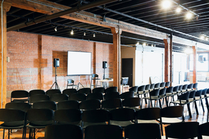 Interior of conference room with projection screen and chairsの写真素材 [FYI02307690]