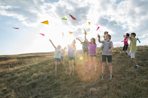 Children throwing paper aeroplanes during field tripの写真素材 [FYI02307924]