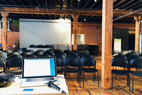 Interior of conference room with laptop and microphone on tableの写真素材 [FYI02308160]