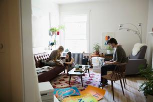 Young activists meeting planning in living roomの写真素材 [FYI02309486]