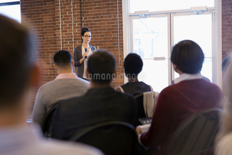 Businesswoman with microphone leading conference meetingの写真素材 [FYI02314681]