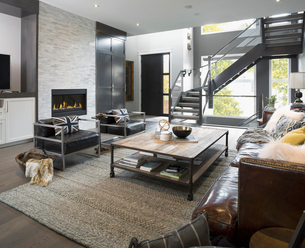 Elegant, modern home showcase interior living room and staircaseの写真素材 [FYI02315494]