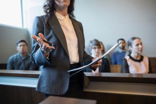 Female attorney talking and gesturing in legal trial courtroomの写真素材 [FYI02317694]