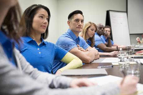 Physiotherapists listening in conference room meetingの写真素材 [FYI02319340]