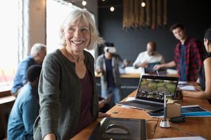 Portrait confident senior female designer at graphics tablet in officeの写真素材 [FYI02323487]