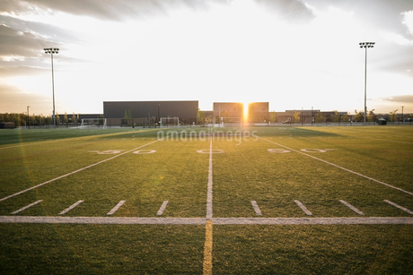 Sunny football field at sunsetの写真素材 [FYI02324229]