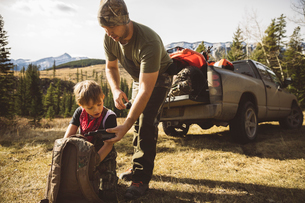 Father and son hunters with walkie-talkie and backpack preparing for huntingの写真素材 [FYI02325264]