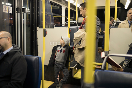 Father and son riding busの写真素材 [FYI02325595]