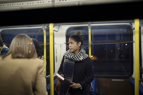 Businesswoman commuter with book riding busの写真素材 [FYI02326071]