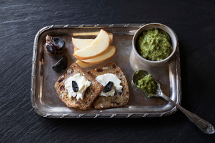 Still life nut bread with spreads and fruit on silver trayの写真素材 [FYI02326505]