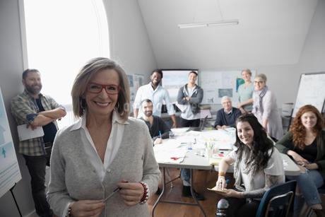 Portrait smiling, confident city planner and volunteers working in officeの写真素材 [FYI02329587]