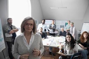 Portrait confident city planner and volunteers working in officeの写真素材 [FYI02329808]