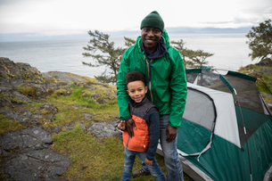 Portrait smiling father and son campingの写真素材 [FYI02329815]