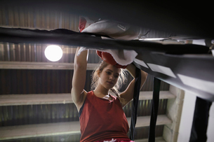 Tough female boxer resting in boxing ring cornerの写真素材 [FYI02335312]