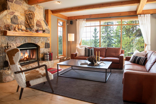 Home showcase interior living room with leather sofas and stone fireplaceの写真素材 [FYI02335925]