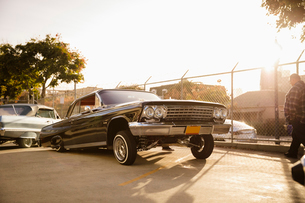 Low rider car in sunny parking lotの写真素材 [FYI02336374]
