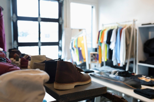 Clothing and shoes in menswear clothing shopの写真素材 [FYI02337533]