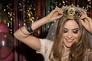 Happy bachelorette adjusting crownの写真素材 [FYI02337613]