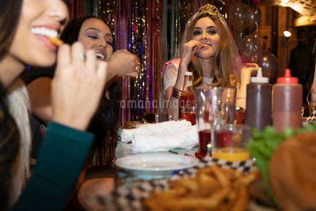 Bachelorette and friends eating at late night dinerの写真素材 [FYI02337663]