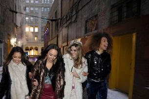 Bachelorette and friends walking in urban alleyの写真素材 [FYI02337678]
