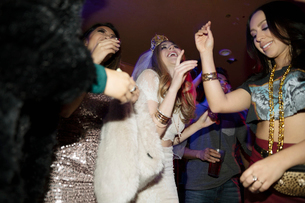 Carefree bachelorette and friends dancing in nightclubの写真素材 [FYI02337712]
