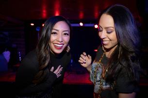 Portrait laughing women friends in nightclubの写真素材 [FYI02337746]