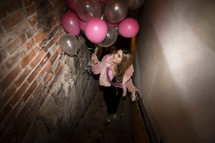 Bachelorette with balloons in stairwellの写真素材 [FYI02337777]