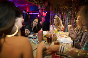 Bachelorette and friends eating in nightclubの写真素材 [FYI02337791]