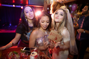 Bachelorette and friends celebrating in nightclubの写真素材 [FYI02338003]