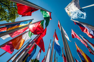 Flags on steel masts, flying in the wind, Munich, Upperの写真素材 [FYI02338145]