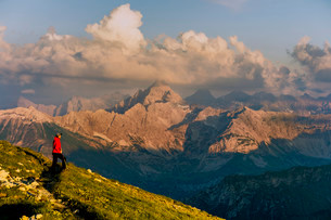 Dark clouds above the Allgau Alps with mountain hikerの写真素材 [FYI02338778]