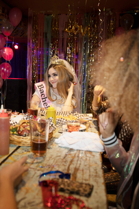 Bachelorette enjoying party, eating with friendsの写真素材 [FYI02338872]