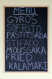 Menu on a blackboard, Greek dishes, gyros, Sofritoの写真素材 [FYI02339493]