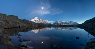 Moon and Mont Blanc reflected in the Lac des Chesery afterの写真素材 [FYI02339586]