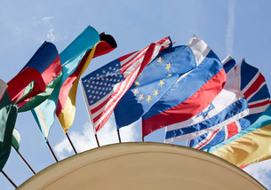 Flags, various nations above the entrance to hotel Astoriaの写真素材 [FYI02339649]
