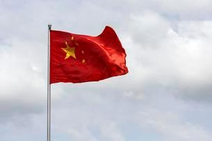 Chinese flag blowing in windの写真素材 [FYI02339707]